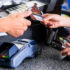 Customer gives credit card to salesperson; copyright: panthermedia.net / Kzenon
