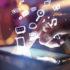 Hand, die auf Tablet zeigt, dadrüber fliegen verschiedene Icons; copyright: PantherMedia / peshkova