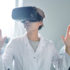 Frau im Kittel mit VR-Brille; copyright: PantherMedia / SeventyFour