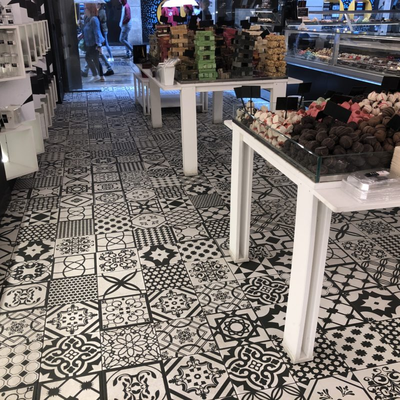 A tiled floor with black and white patterns in a shop